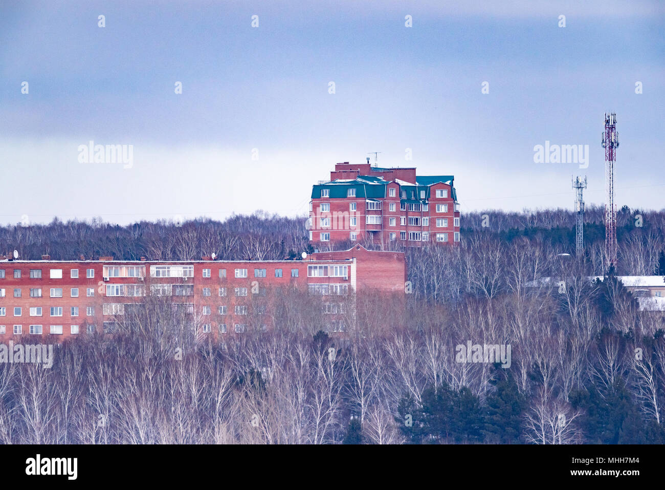 Multi-storey construction outside the city. Residential area among the forest. - Stock Image