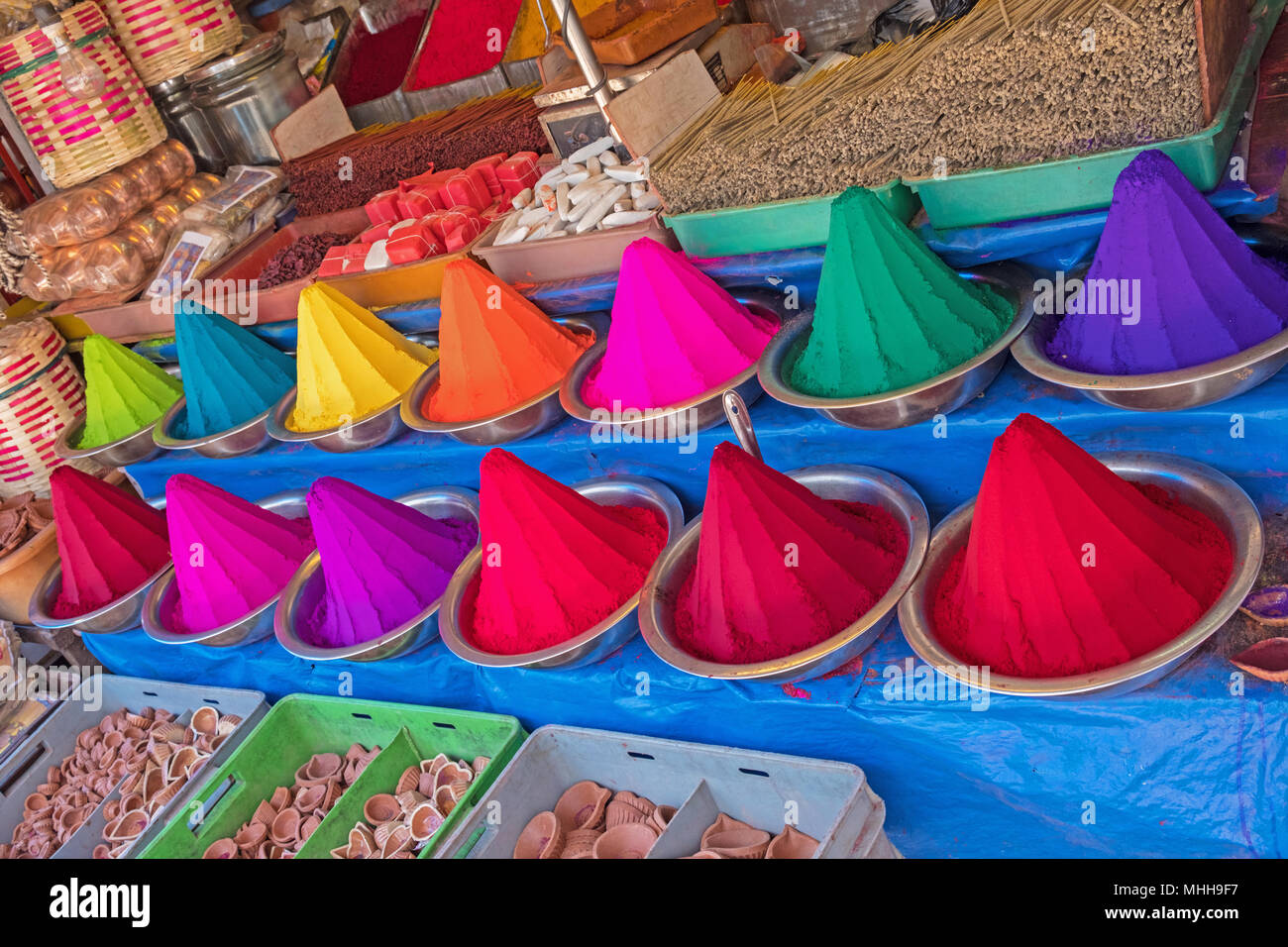 Rangoli powder, incense and joss sticks on display in an Indian market. - Stock Image