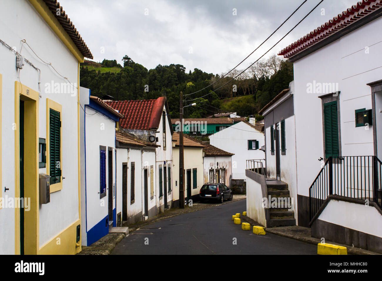 Houses along street in small town - Stock Image