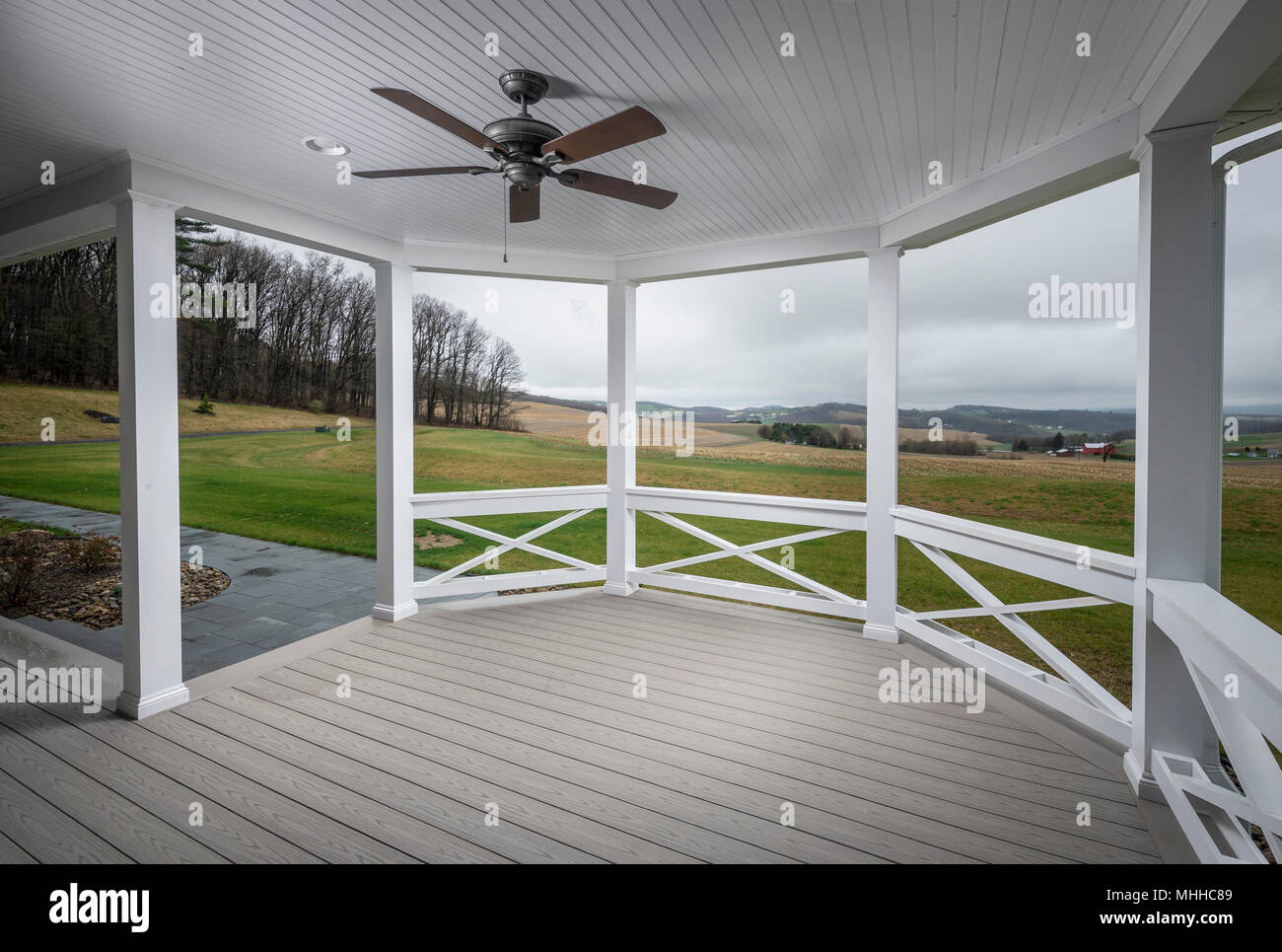 Large Empty Porch Overlooking Farmland - Stock Image