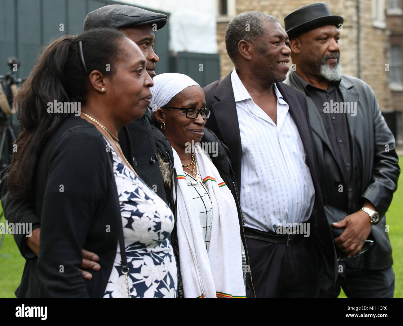 Members of the Windrush generation (left to right) Sarah O'Connor, 56, who arrived from Jamaica in 1967; Anthony Bryan, aged 60, who arrived from Jamaica in 1965; Paulette Wilson, 62, who arrived from Jamaica in 1968; Sylvester Marshall, 63, who arrived from Jamaica in 1973, and Elwaldo Romeo, 63, who arrived from Antigua in 1959, during a photocall in Westminster, London. - Stock Image