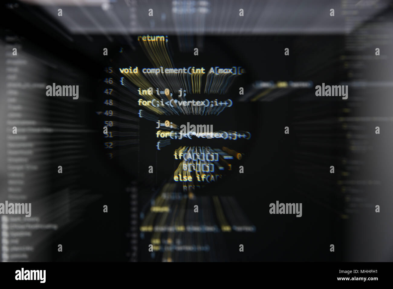 Real c / c++ code developing screen. Programing workflow abstract algorithm concept. Lines of c / c++ code visible under magnifying lens with moviment - Stock Image