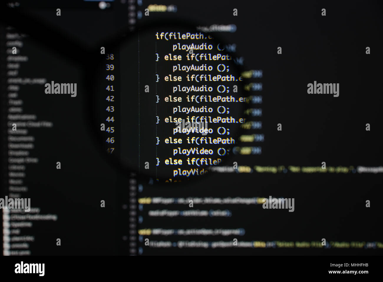 Real c / c++ code developing screen. Programing workflow abstract algorithm concept. Lines of c / c++ code visible under magnifying lens. - Stock Image