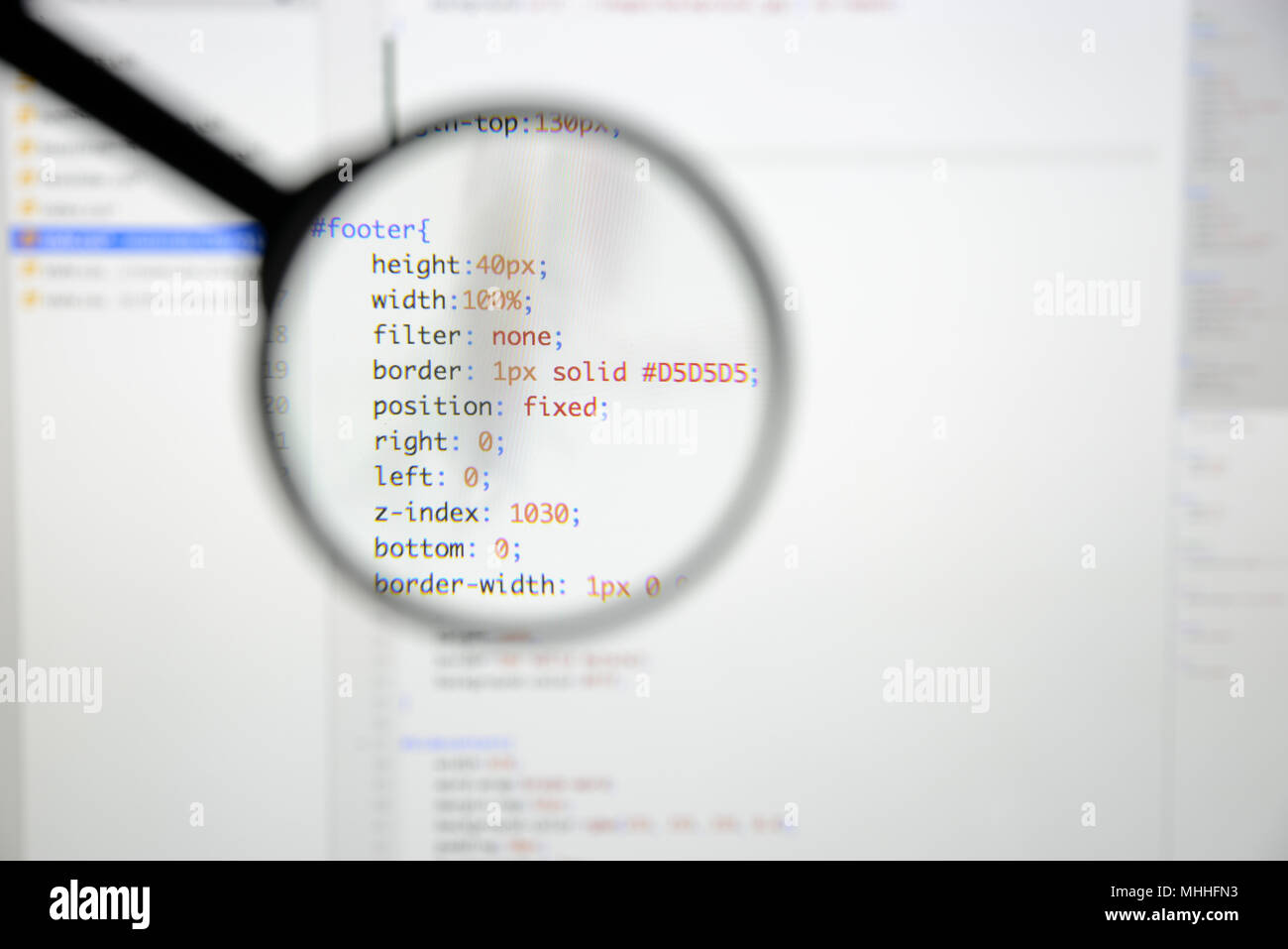 Real css code developing screen. Programing workflow abstract algorithm concept. Lines of css code visible under magnifying lens. - Stock Image