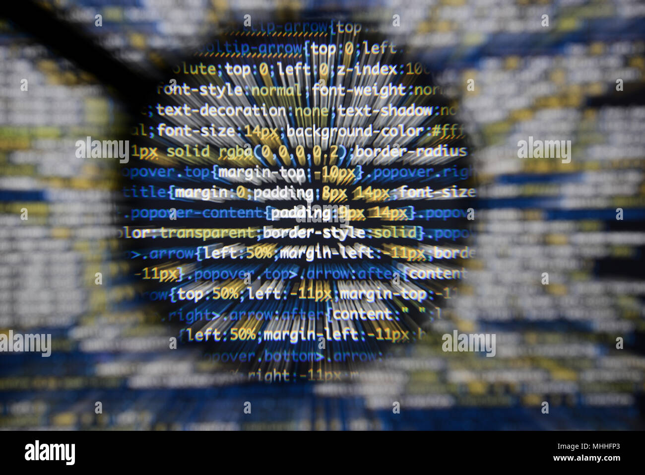 Real css code developing screen. Programing workflow abstract algorithm concept. Lines of css code visible under magnifying lens with moviment effect. - Stock Image
