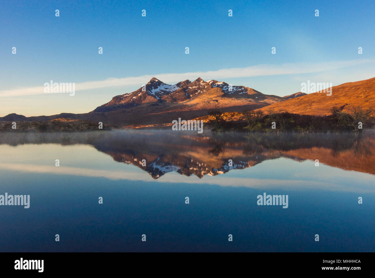 Sunrise Contrail over the Cuillin - Stock Image