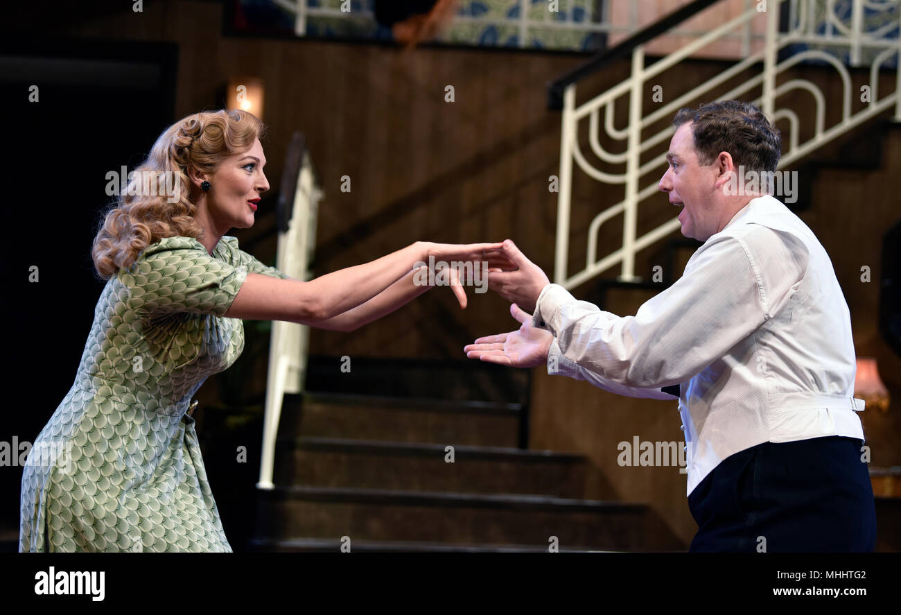 Rufus Hound (playing Garry Essendine) and Katherine Kingsley (playing Liz Essendine) in a scene from Present Laughter by Noel Coward, Chichester, UK. - Stock Image