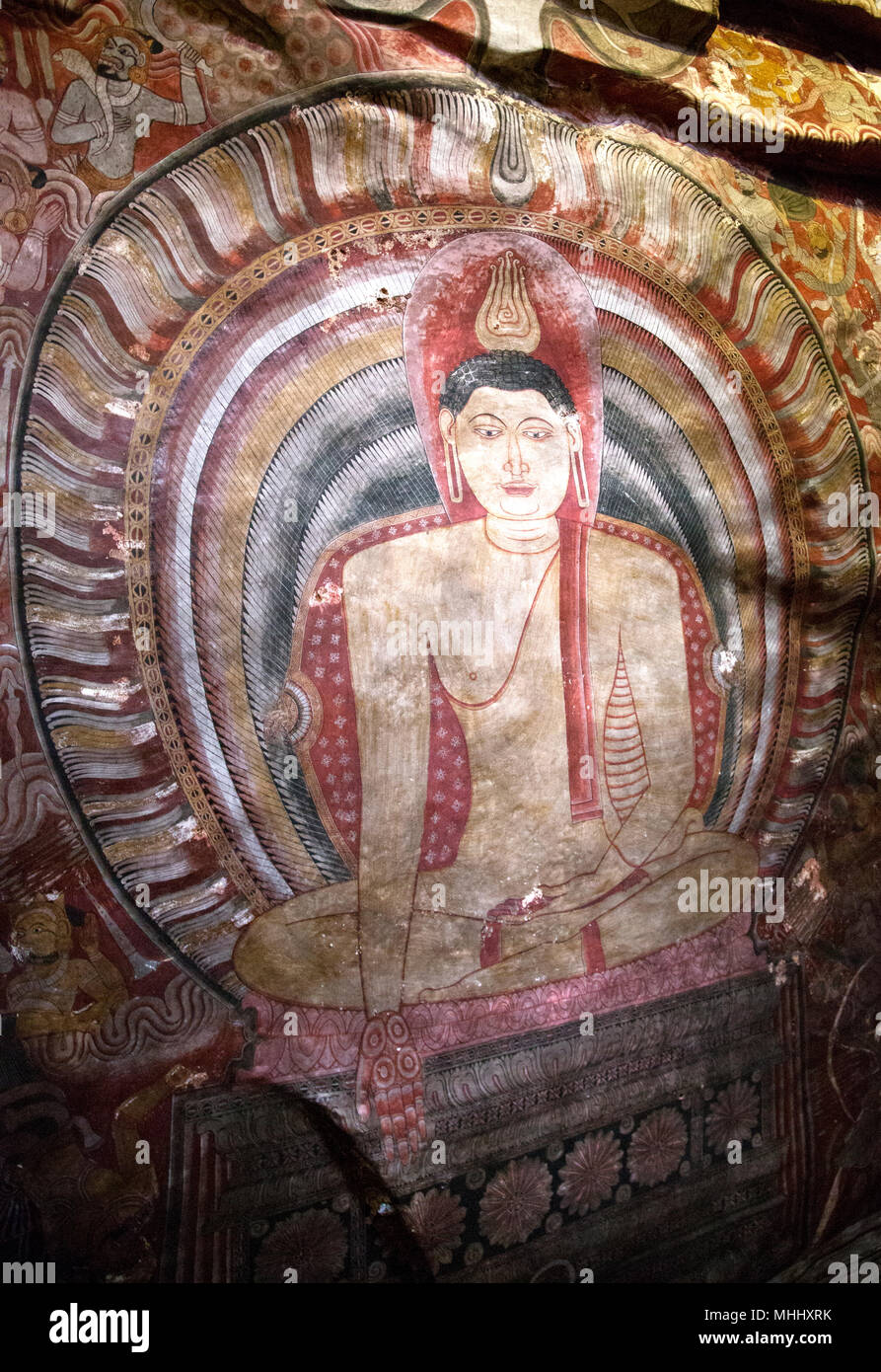 Dambulla Sri Lanka Dambulla Cave Temples - Cave II  Maharaja Viharaya Painting Of Buddha In Varada Mudra Gesture Of Charity And Compassion - Stock Image