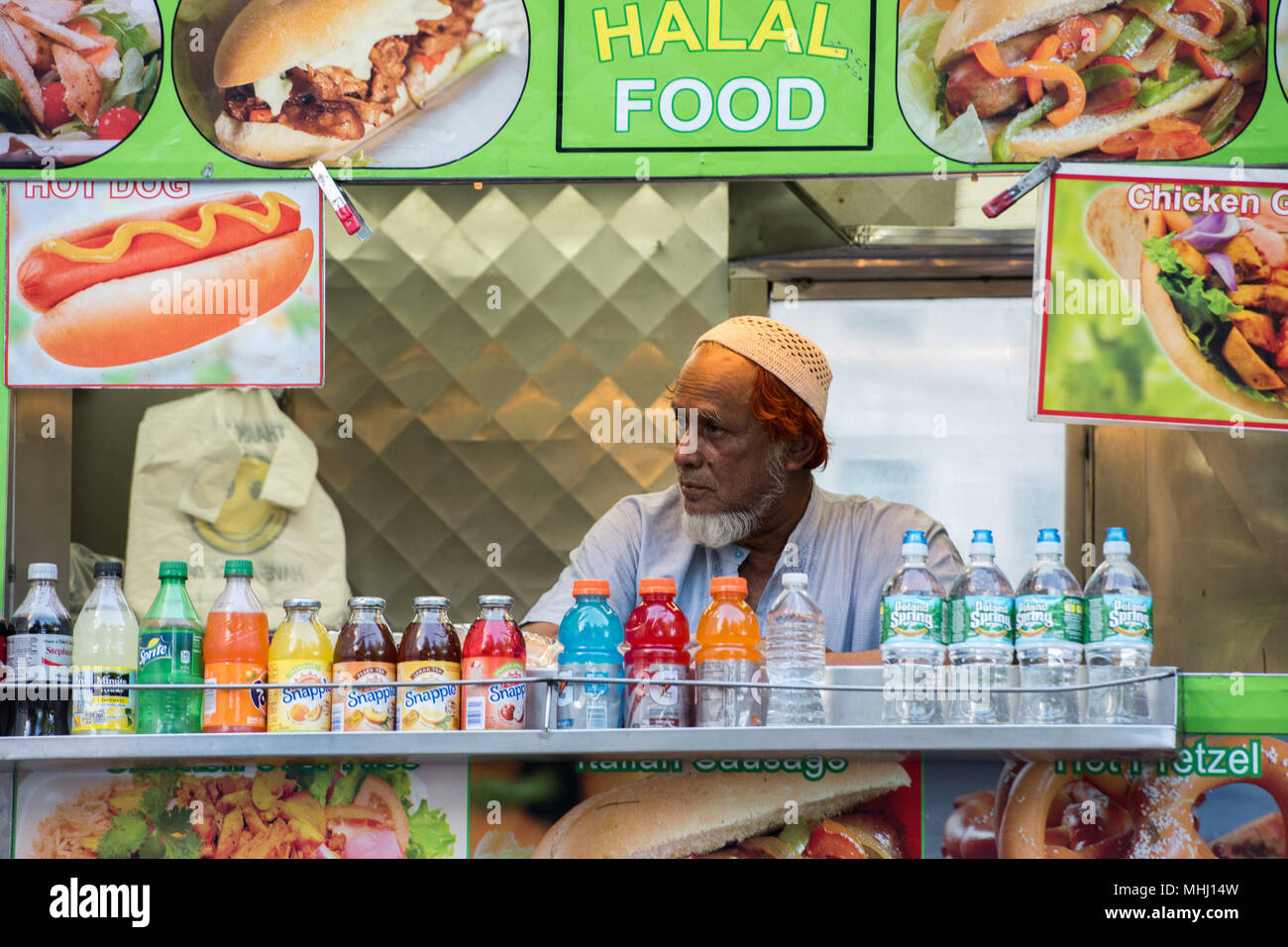 NEW YORK - USA - 13 JUNE 2015 - Arabic man while selling