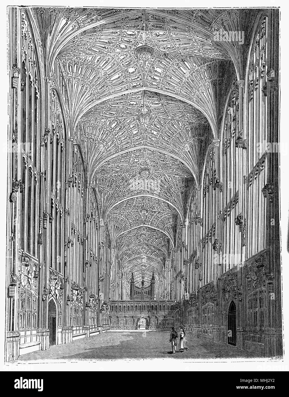 The Interior of King's College Chapel in the University of Cambridge. Considered to be one of the finest examples of late Perpendicular Gothic English architecture, it was built in phases by a succession of kings of England from 1446 to 1515, a period which spanned the Wars of the Roses. The chapel's large stained glass windows were not completed until 1531, and its early Renaissance rood screen was erected in 1532–36. The chapel is an active house of worship, and home of the King's College Choir. Stock Photo