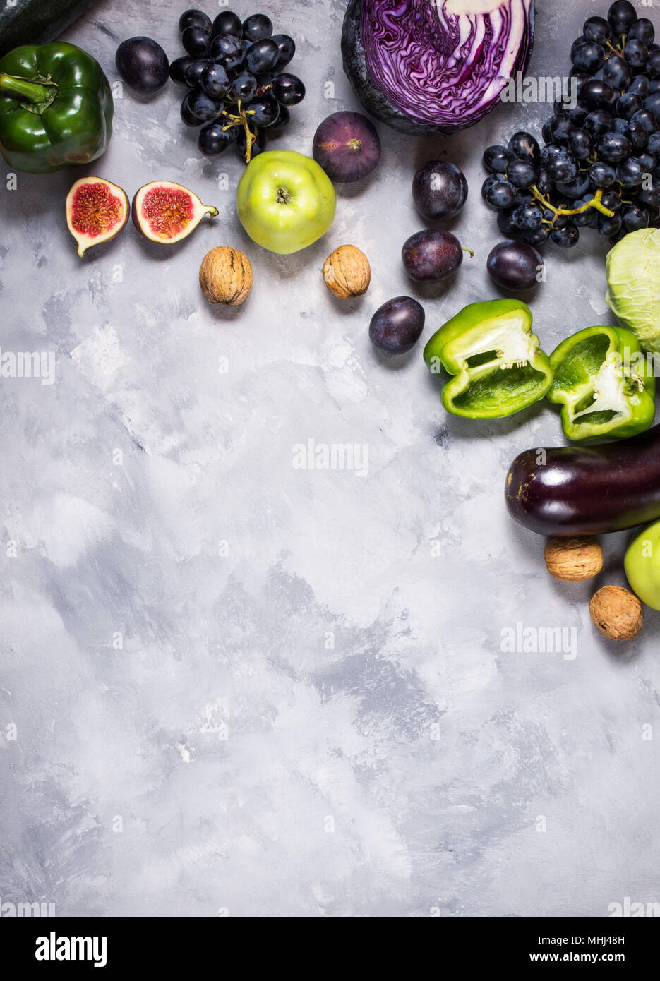 Fresh organic raw green and purple colored vegetables and ...