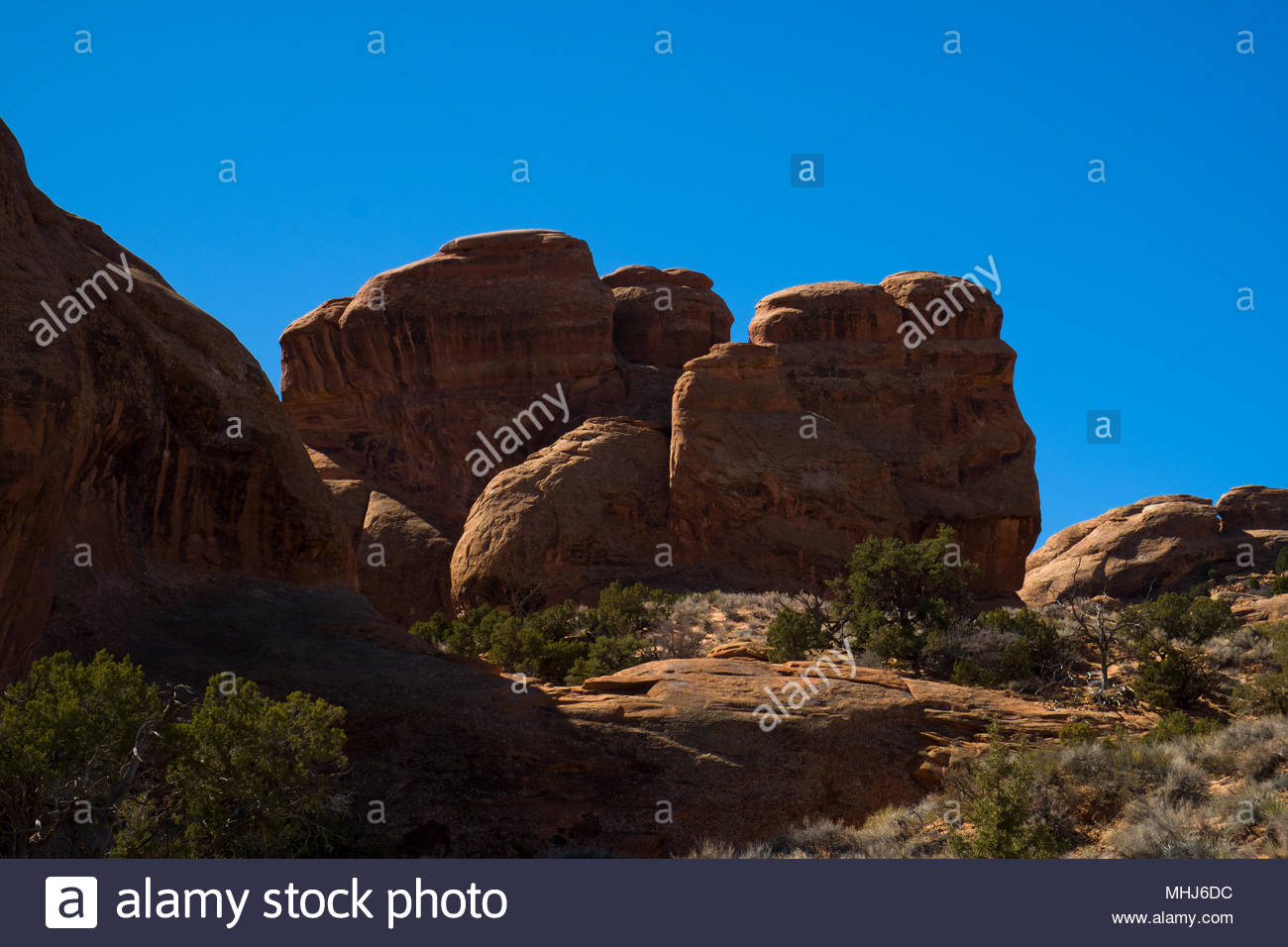 Natural rock formations seen from the Devils Garden Trail in Arches National Park, Grand County, Utah, USA - Stock Image