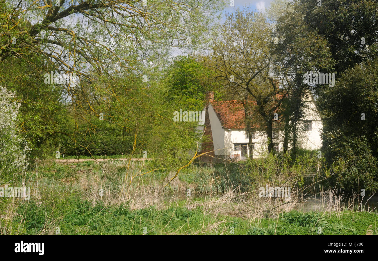 Willy Lott's Cottage from across the River Stour in Flatford, Suffolk, England - Stock Image