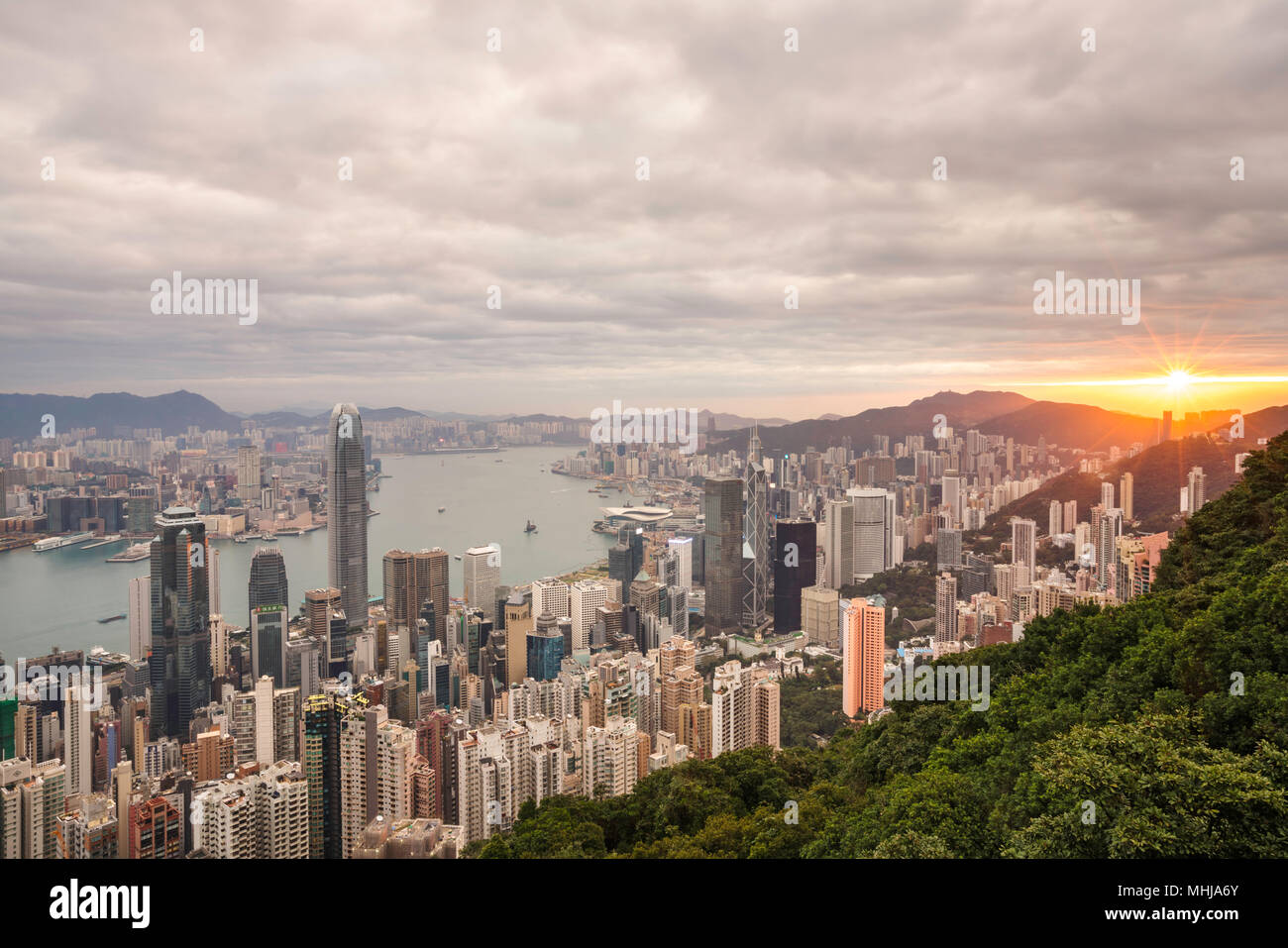 A view of the Hong Kong skyline looking east at twilight - Stock Image