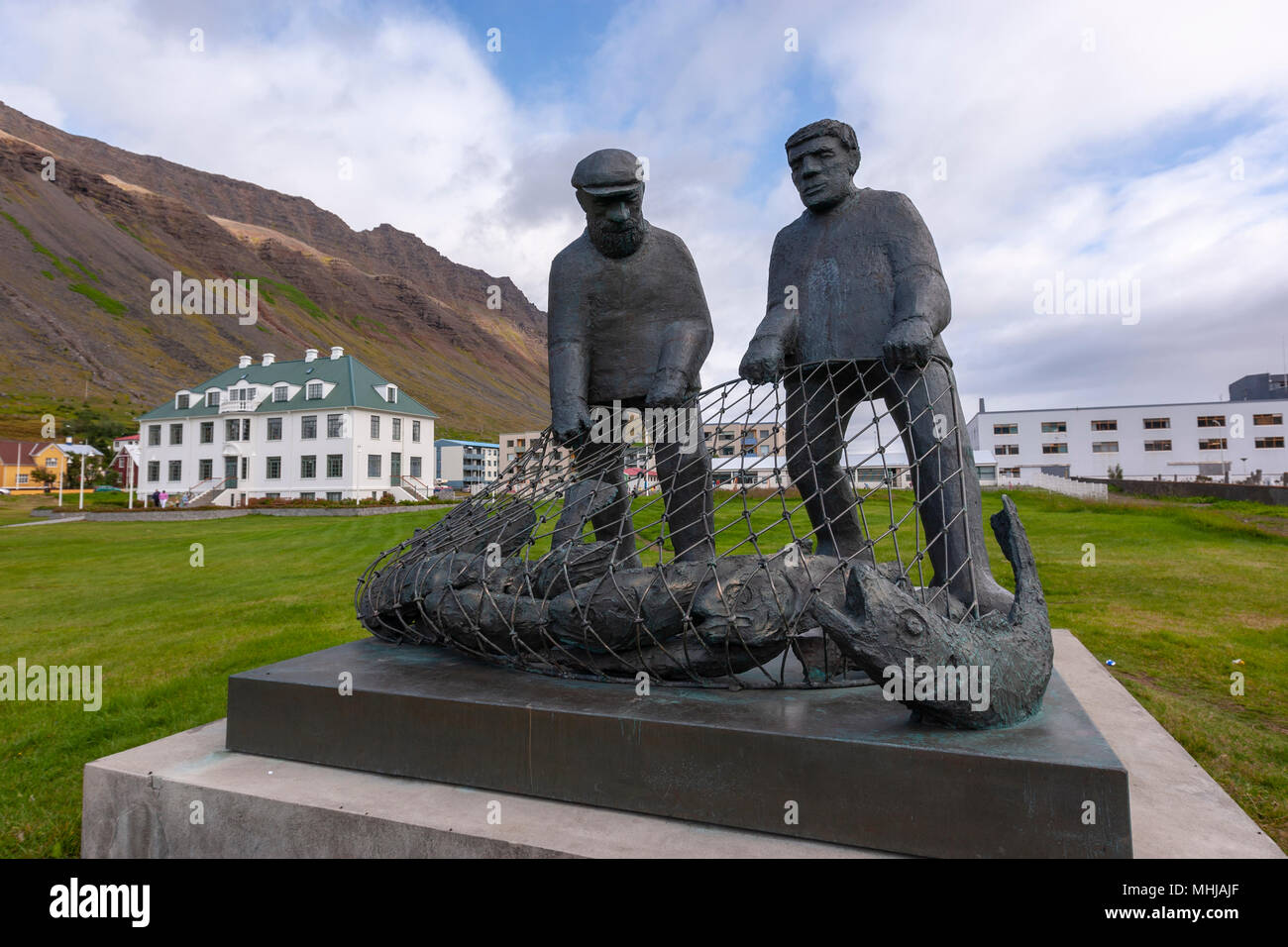 Two fishermen monument sculpture, by the sculptor Ragnar Kjartansson , in Isafjordhur town in the northwest of Iceland. - Stock Image