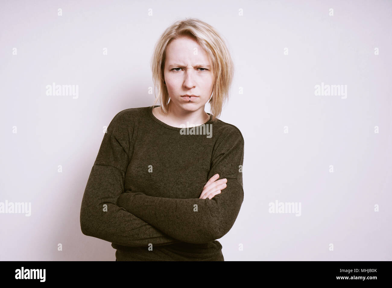 Angry Young Woman Frowning With Arms Crossed Negative Emotion Concept Copy Space