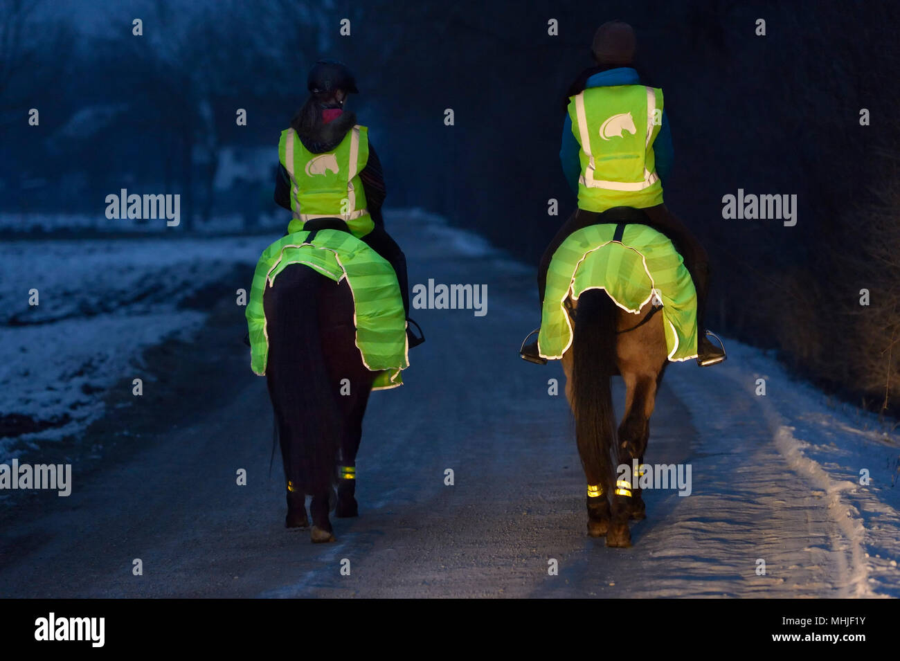 Ride out in the evening wearing reflective items for safety - Stock Image
