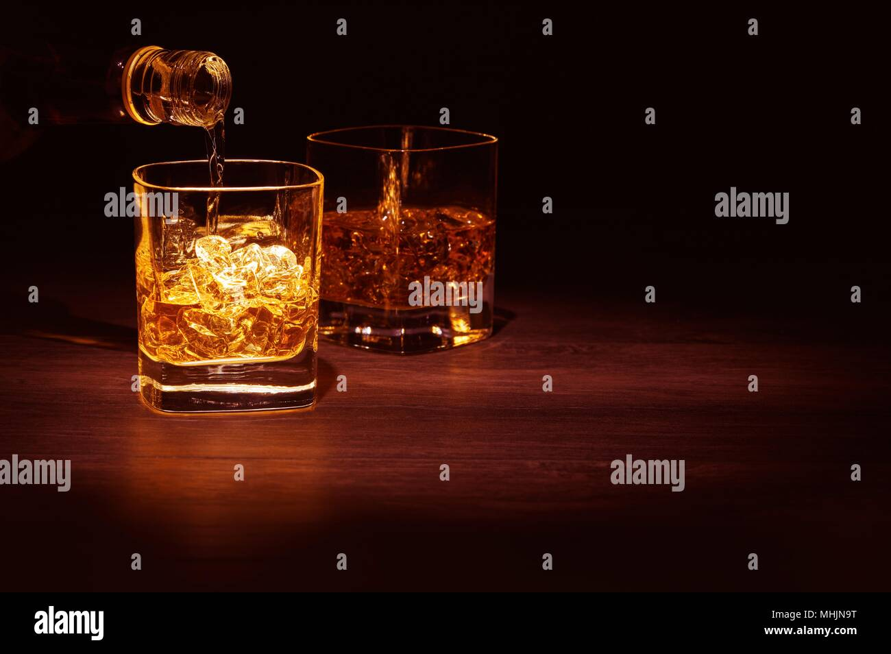 Close-Up Of Wine Glasses Against Black Background  Beer - Alcohol   Cocktail Blended Drink - Stock Image