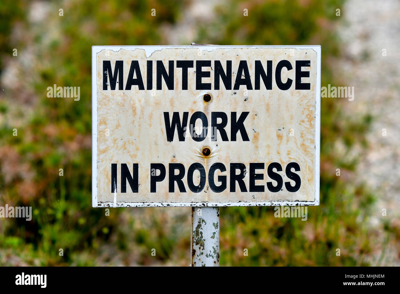 Maintenance work in progress sign board - Stock Image