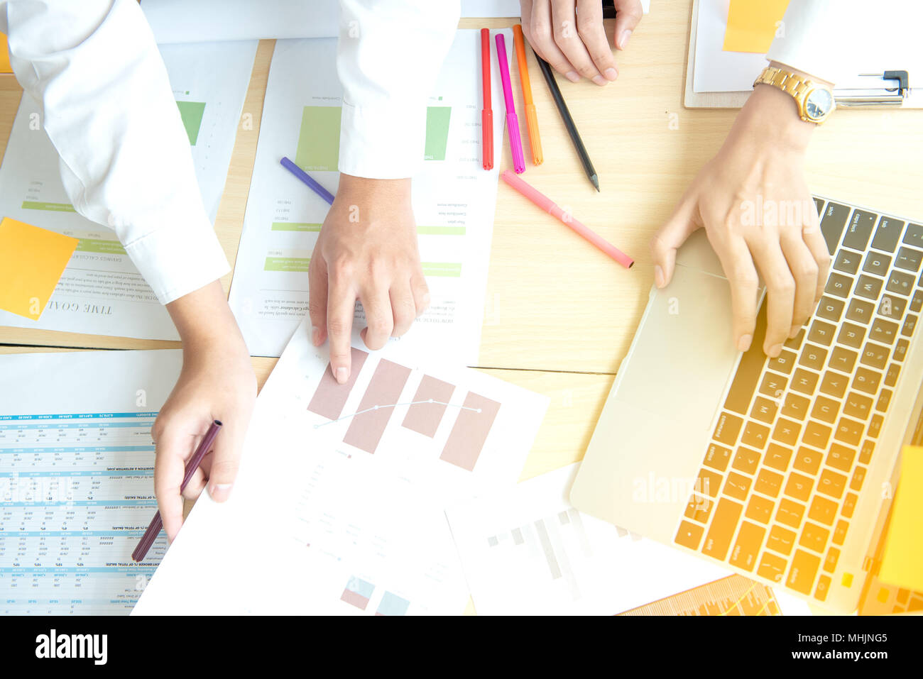 business group working check chart and paper data with laptop on desk in office - Stock Image
