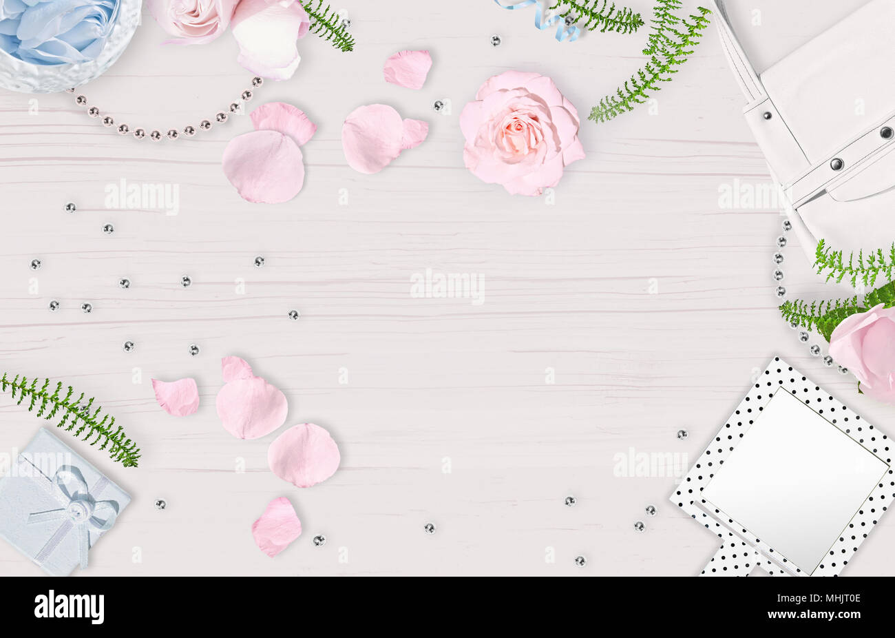 white feminine background flat lay pink roses mirror white bag