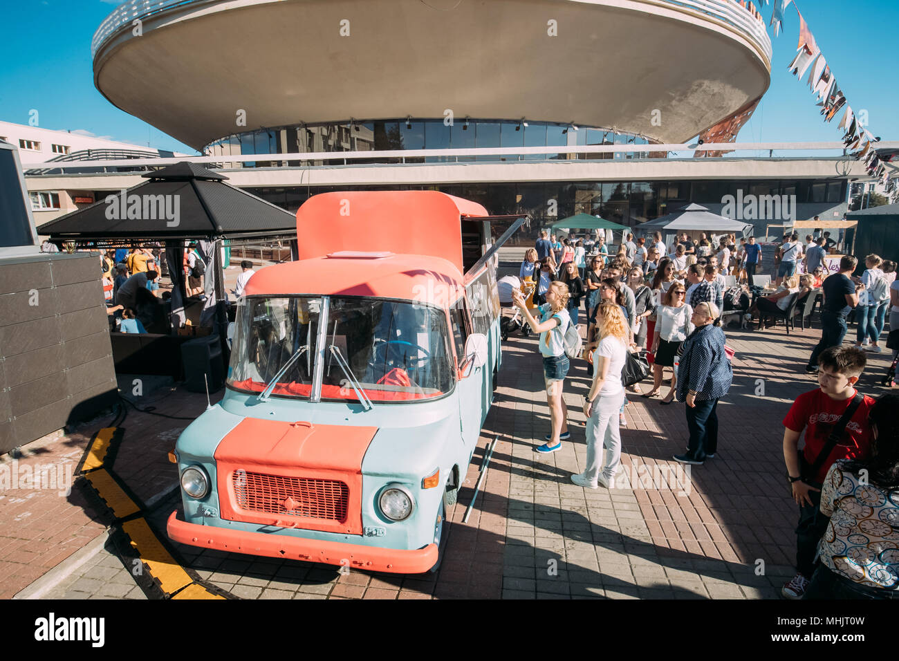 Gomel, Belarus. People Walking Near Food Car On Gastronomic Festival City Food In Summer Sunny Day. - Stock Image