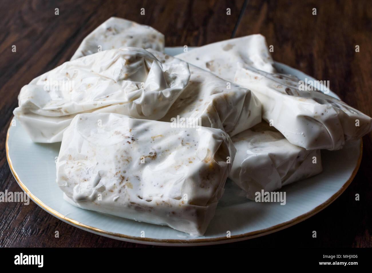 Turkish Helva Sakiz Helvasi / Gum Halva with Walnut. Traditional Food. - Stock Image