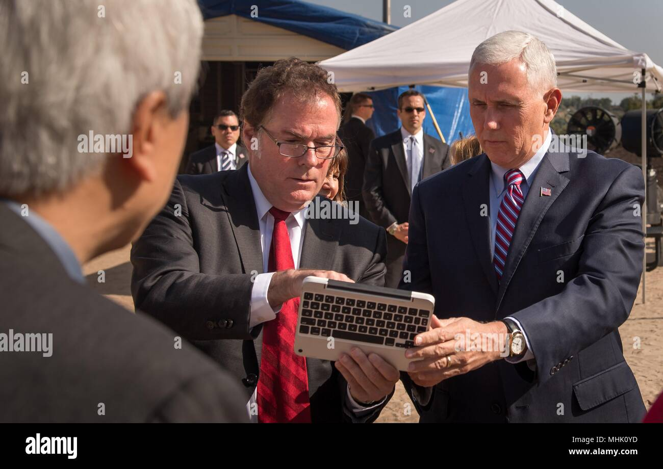 U.S. Vice President Mike Pence is given instructions on how to drive a rover nicknamed 'Scarecrow' by JPL Director Michael Watkins, center, during a visit to the NASA Jet Propulsion Laboratory Mars Yard April 28, 2018 in Pasadena, California. Scarecrow is used to test mobility of rovers on Mars. - Stock Image