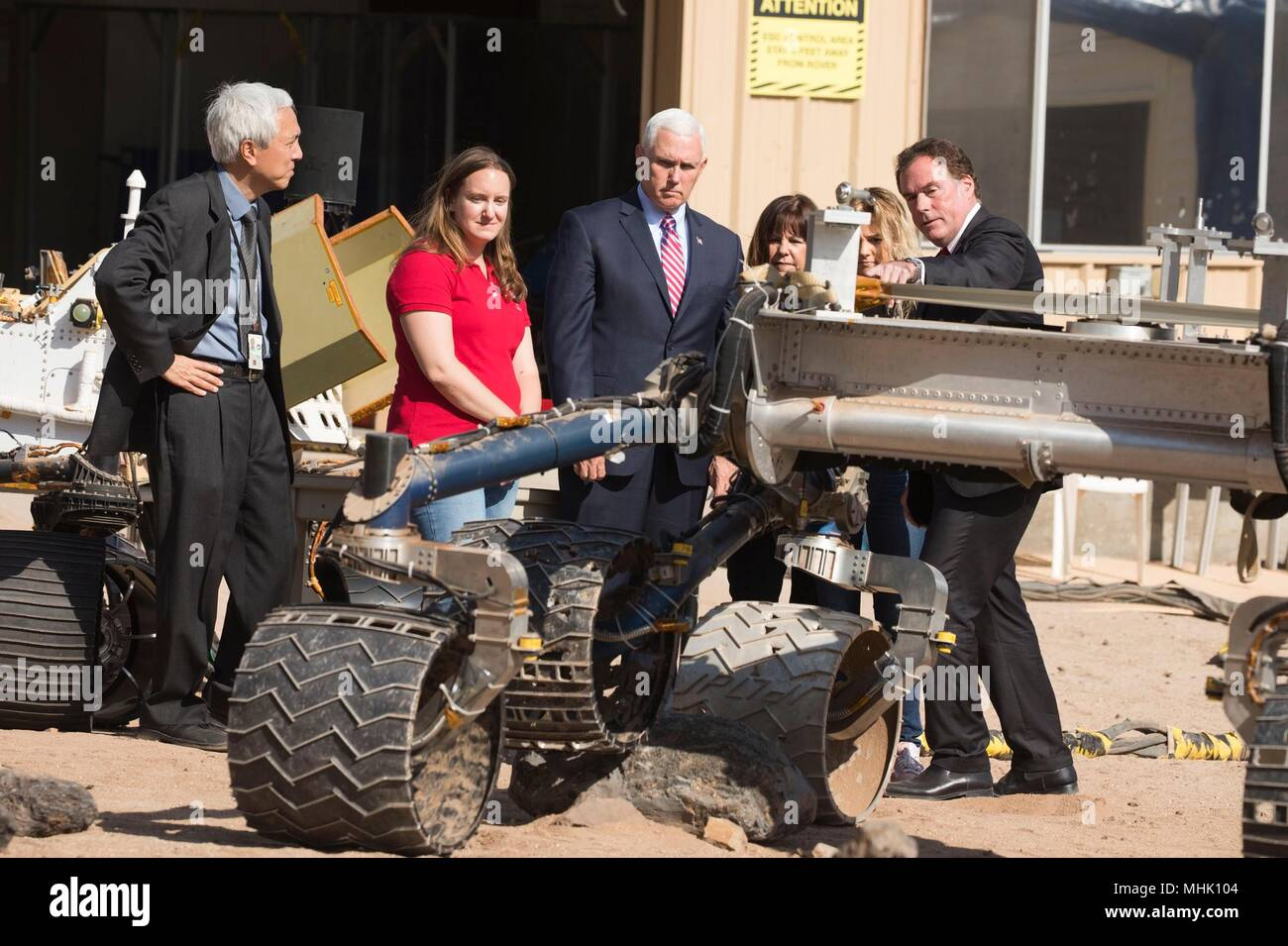 U.S. Vice President Mike Pence, center, views a rover nicknamed 'Scarecrow' during a visit to the NASA Jet Propulsion Laboratory Mars Yard April 28, 2018 in Pasadena, California. Standing from left to right are: NASA Mars Exploration Manager Li Fuk, Mars Curiosity Engineering Operations Team Chief Megan Lin, Vice President Mike Pence, Karen Pence, daughter Charlotte Pence, and JPL Director Michael Watkins. - Stock Image