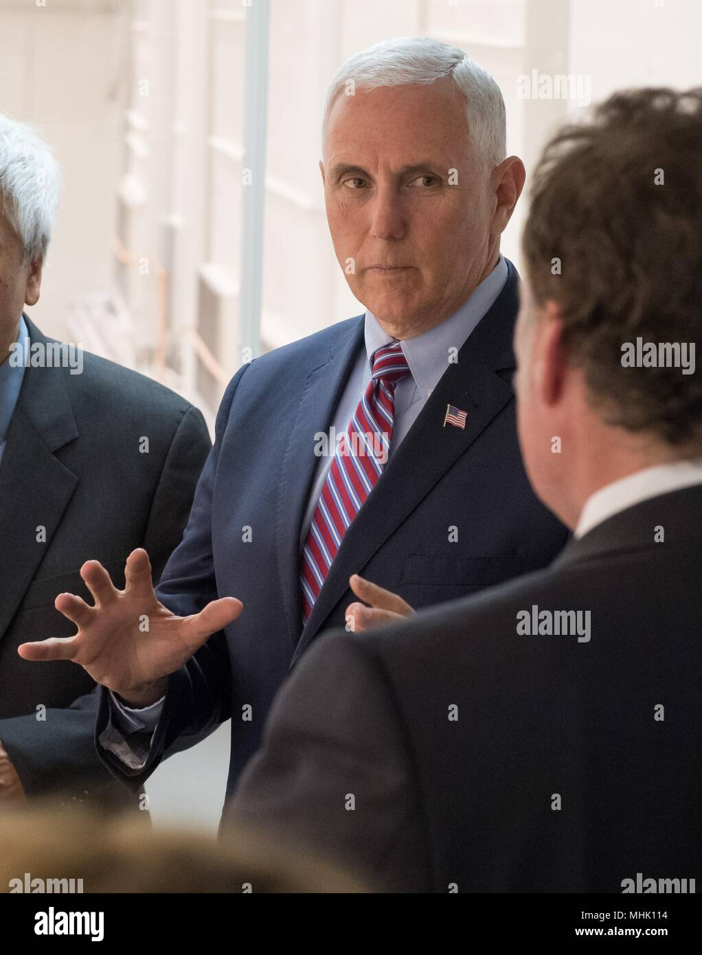 U.S. Vice President Mike Pence, center, talks with JPL Director Michael Watkins, left, during a tour of the NASA Jet Propulsion Laboratory April 28, 2018 in Pasadena, California. - Stock Image