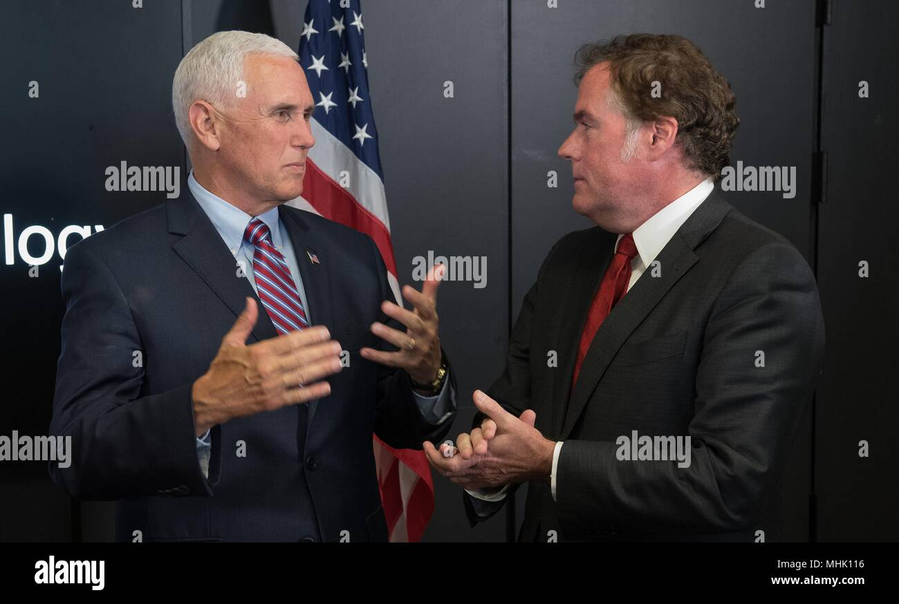 U.S. Vice President Mike Pence, talks with JPL Director Michael Watkins, right, during a tour of the NASA Jet Propulsion Laboratory April 28, 2018 in Pasadena, California. - Stock Image