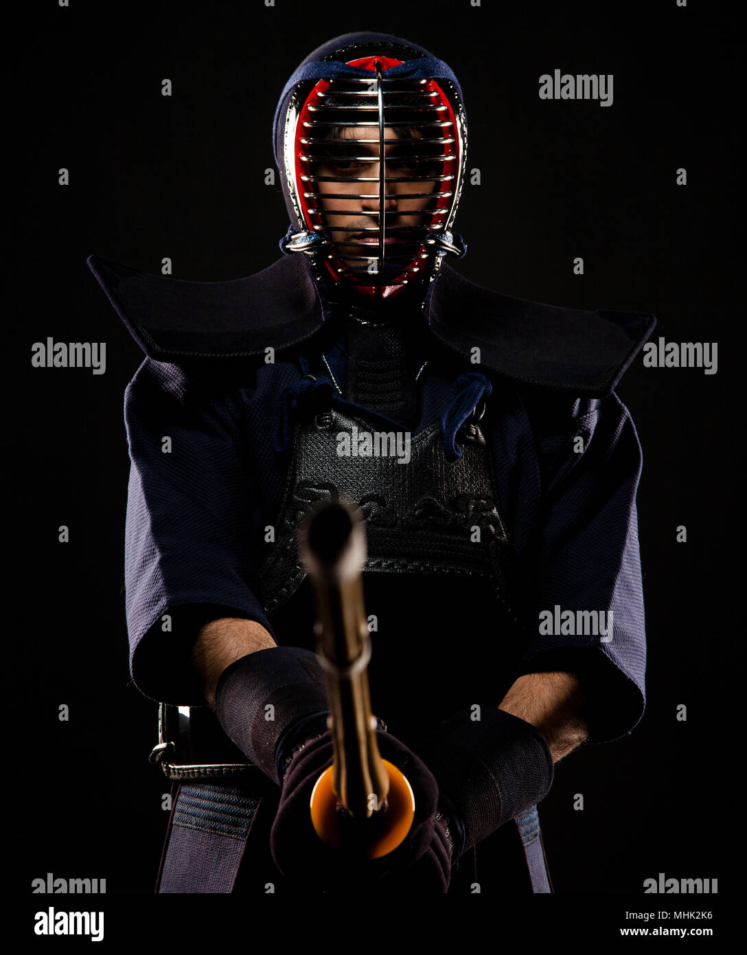 A confident kendoka geared in his bogu and wielding a shinai in preparation of Kendo - traditional Japanese Martial Art. - Stock Image