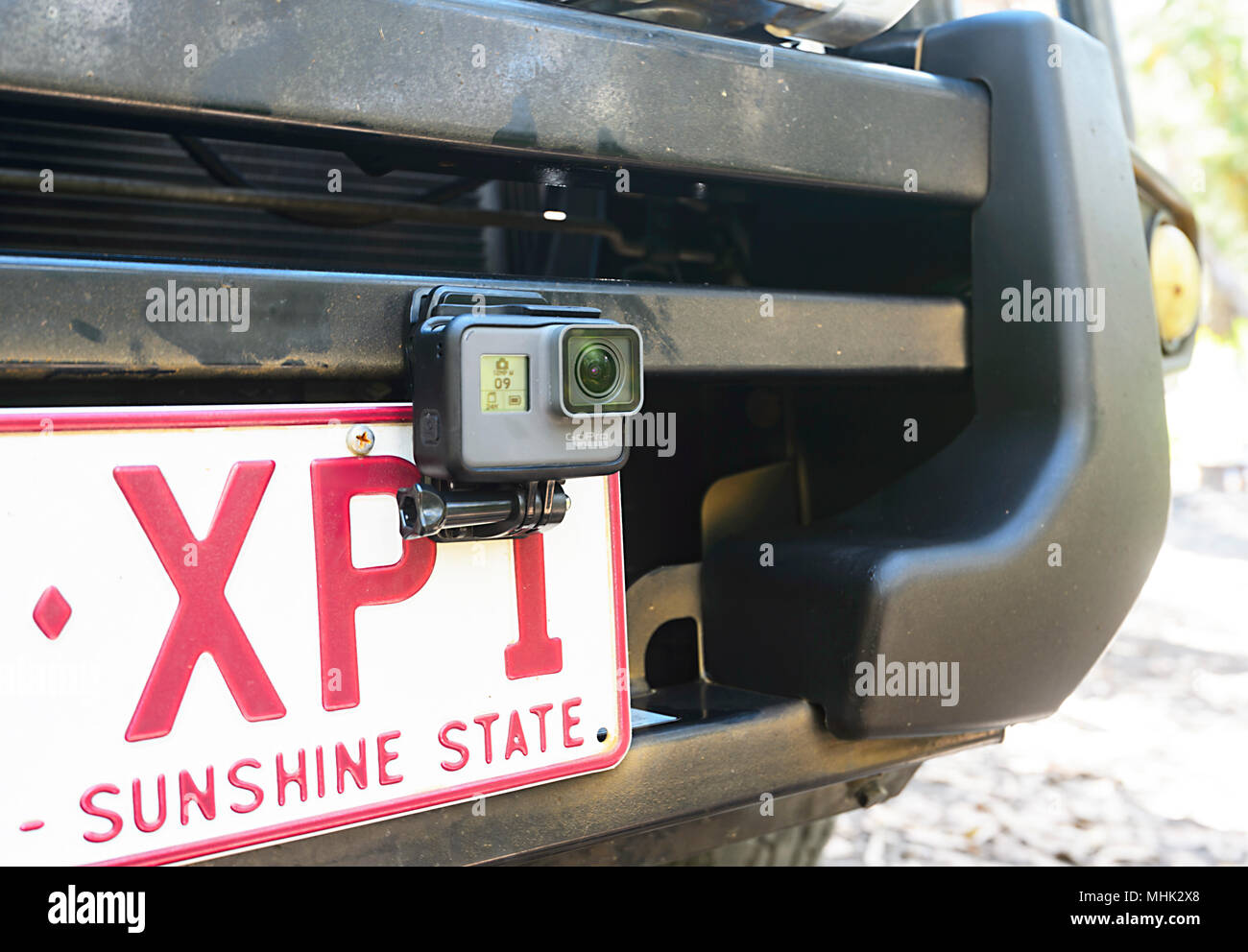 A GoPro Hero 6 camera attached to the front of a car for filming - Stock Image