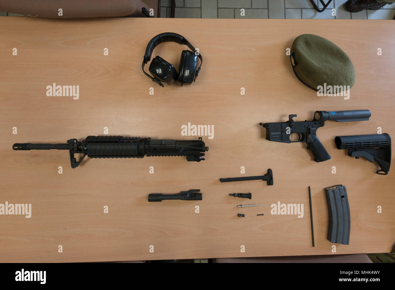 u s m4 carbine is shown in its disassembled state as members of the