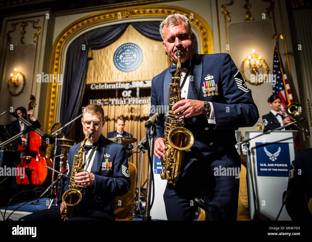 BANGKOK, THAILAND (Mar. 23, 2018) Master Sergeant James Butler, a regional saxophonist assigned to the U.S. Air Force Band of the Pacific, performs at a gala at the Mandarin Oriental Hotel in Bangkok, Thailand. The band is in Thailand as part of the U.S. Embassy's 200th Anniversary Celebration of Friendship between the U.S. and Kingdom of Thailand. (U.S. Air Force - Stock Image