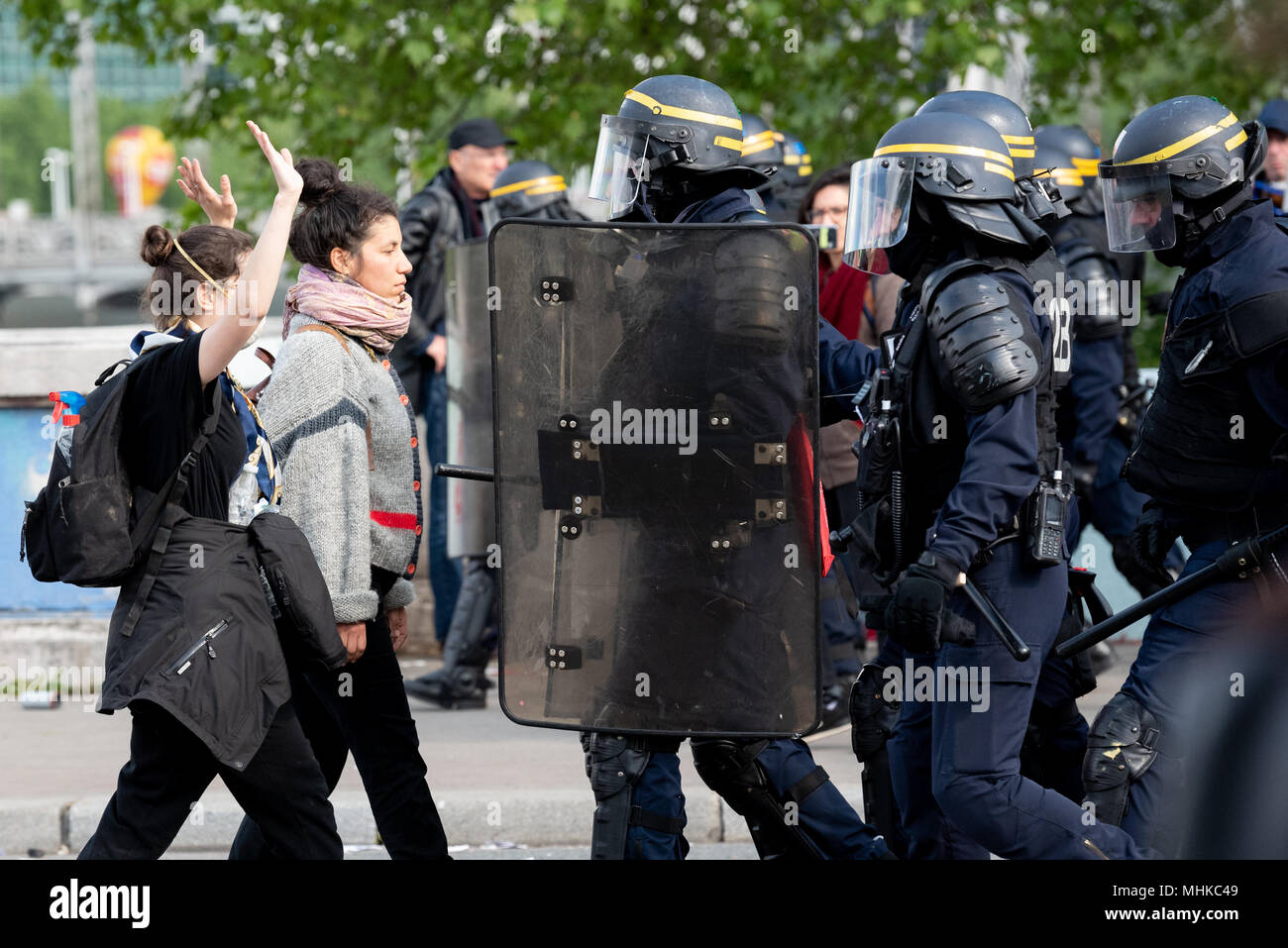 Paris, France. 1st May 2018. Workers Day manifestation. Two females challenge police during the May Day resistance as the police try to clear the area after rioting. 1st May 2018. Paris, France. Credit: Paul Roberts/Alamy Live News Stock Photo