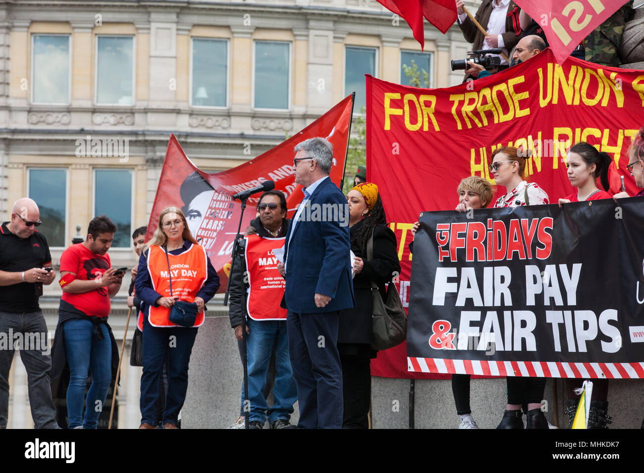 London, UK. 1st May, 2018. Mick Cash, General Secretary of the RMT trade union, addresses representatives of trade unions and socialist and communist parties from many different countries taking part in the annual May Day rally in Trafalgar Square to mark International Workers' Day. Credit: Mark Kerrison/Alamy Live News - Stock Image