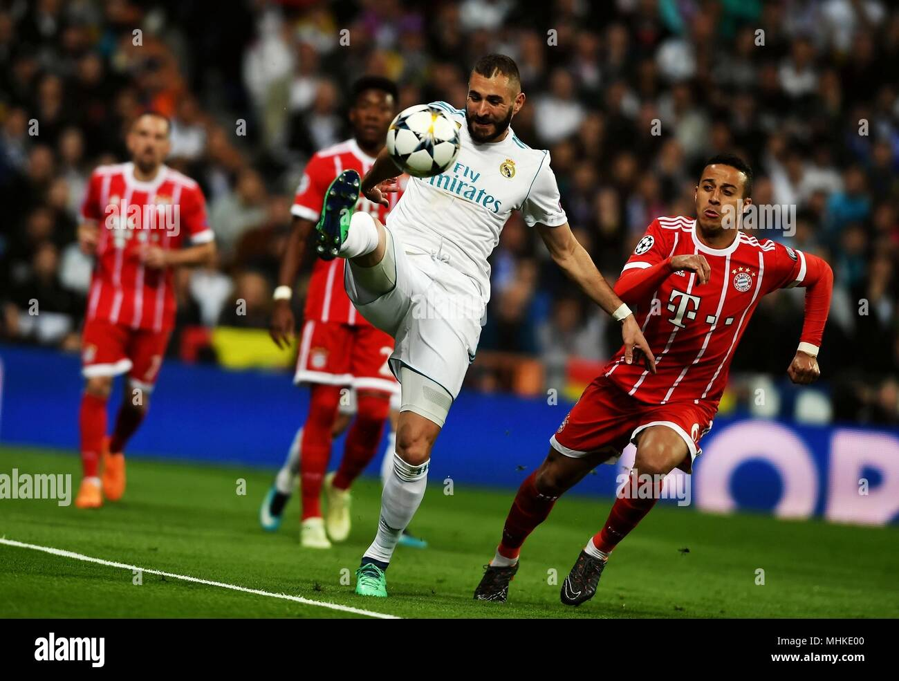 Madrid, Spain. 1st May, 2018. Real Madrid's Karim Benzema (Front) competes during a UEFA Champions League semifinal second leg soccer match between?Spanish team Real Madrid and German team Bayern Munchen in Madrid, Spain, on May 1, 2018. The match ended 2-2. Real Madrid advanced to the final with 4-3 on aggregate. Credit: Guo Qiuda/Xinhua/Alamy Live News - Stock Image