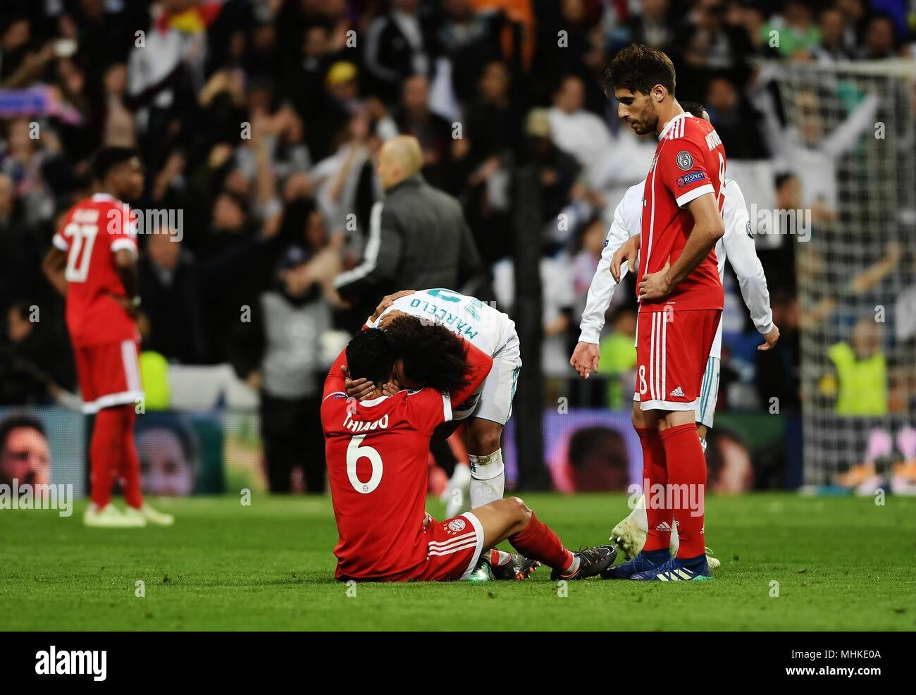 Madrid, Spain. 1st May, 2018. Real Madrid's Marcelo (C Rear) kisses Bayern Munchen's Thiago Alcantara after a UEFA Champions League semifinal second leg soccer match between?Spanish team Real Madrid and German team Bayern Munchen in Madrid, Spain, on May 1, 2018. The match ended 2-2. Real Madrid advanced to the final with 4-3 on aggregate. Credit: Guo Qiuda/Xinhua/Alamy Live News - Stock Image