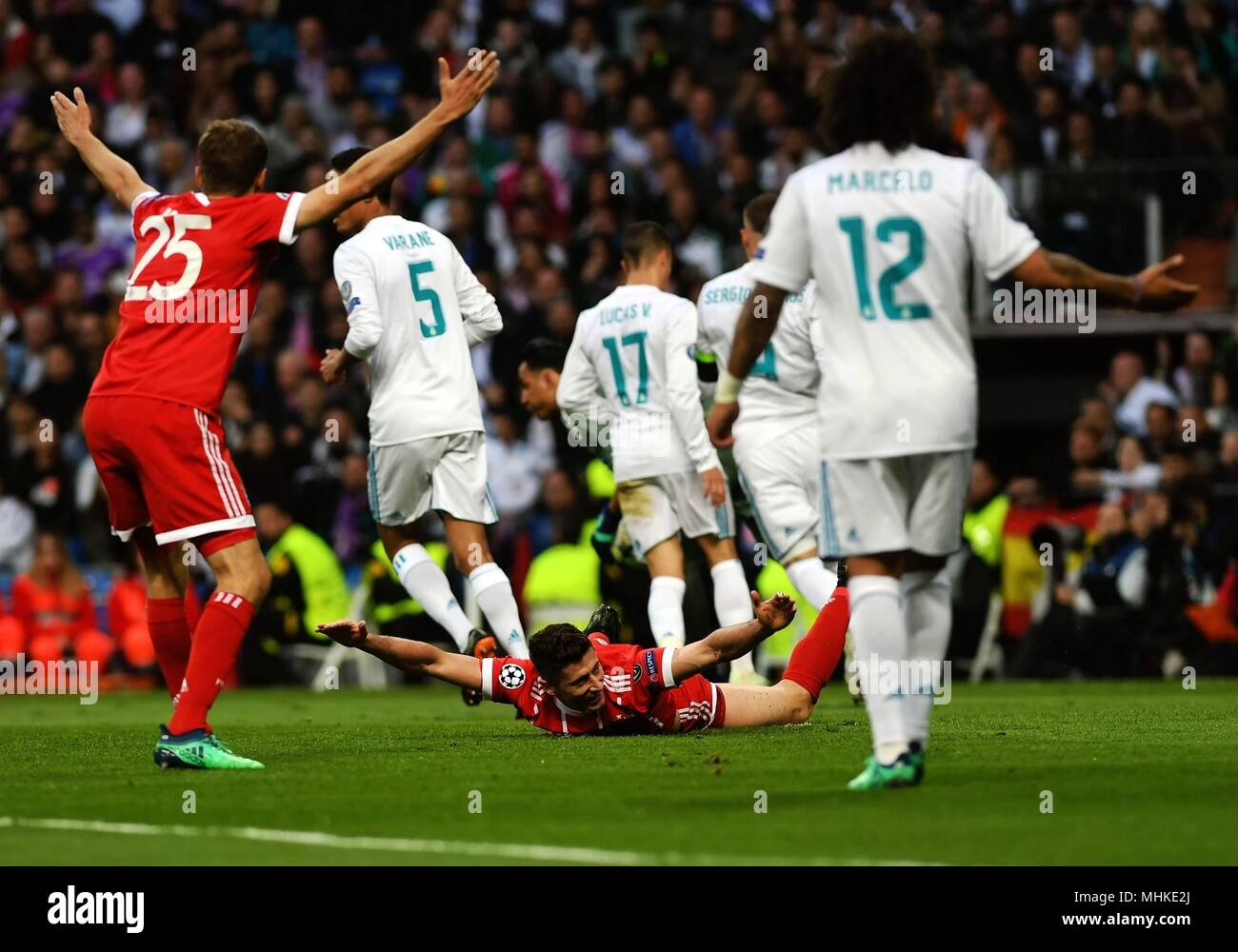 Madrid, Spain. 1st May, 2018. Bayern Munchen's Robert Lewandowski (C) falls on the ground during a UEFA Champions League semifinal second leg soccer match between?Spanish team Real Madrid and German team Bayern Munchen in Madrid, Spain, on May 1, 2018. The match ended 2-2. Real Madrid advanced to the final with 4-3 on aggregate. Credit: Guo Qiuda/Xinhua/Alamy Live News - Stock Image
