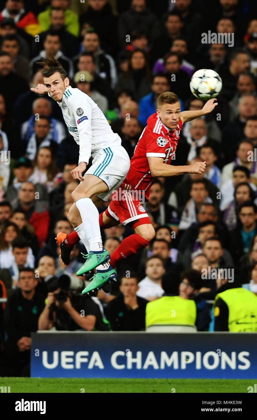 Madrid, Spain. 1st May, 2018. Real Madrid's Gareth Bale (L) plays aerial ball during a UEFA Champions League semifinal second leg soccer match between?Spanish team Real Madrid and German team Bayern Munchen in Madrid, Spain, on May 1, 2018. The match ended 2-2. Real Madrid advanced to the final with 4-3 on aggregate. Credit: Guo Qiuda/Xinhua/Alamy Live News - Stock Image