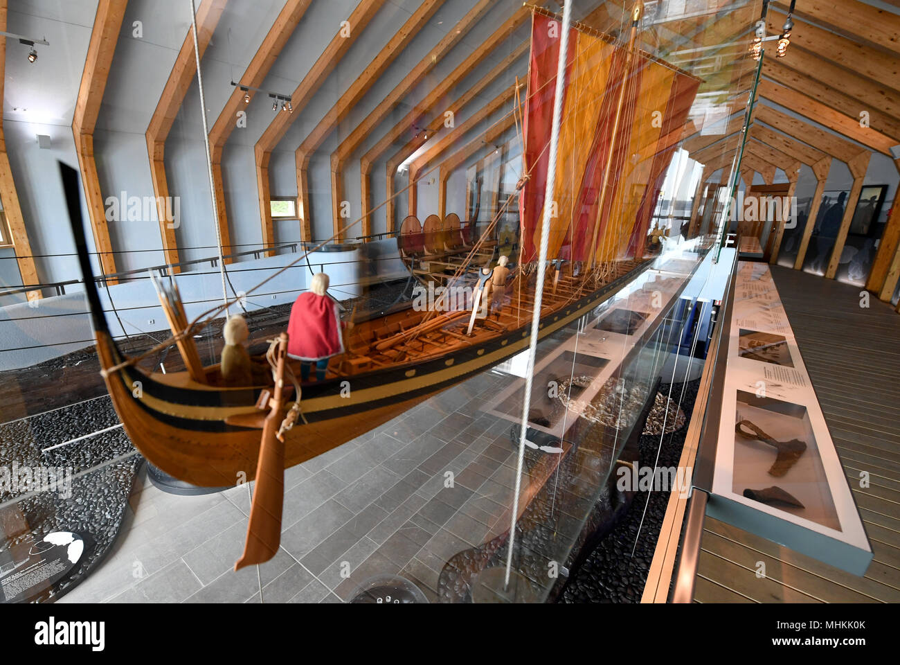 02 May 2018, Germany, Busdorf: A model of a Viking war ship standing in the exhibition of the Viking Museum Haithabu. The museum was closed for 18 months due to extensive renovation work and is to be reopened on 03 May 2018. Photo: Carsten Rehder/dpa - Stock Image