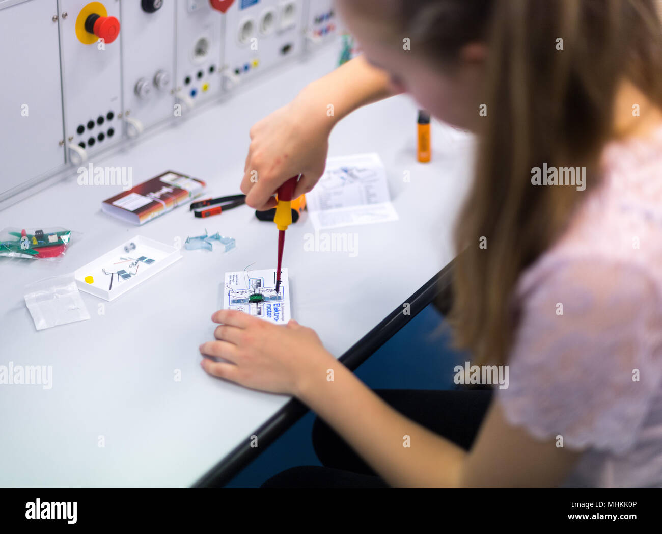 26 April 2018, Leipzig, Germany: A student building an electric motor in the training center of Siemens Professional Education as part of nationwide Girls' Day. On Girls' Day, schoolgirls can get a taste of technical, scientific and craft trades. Photo: Monika Skolimowska/dpa-Zentralbild/dpa - Stock Image