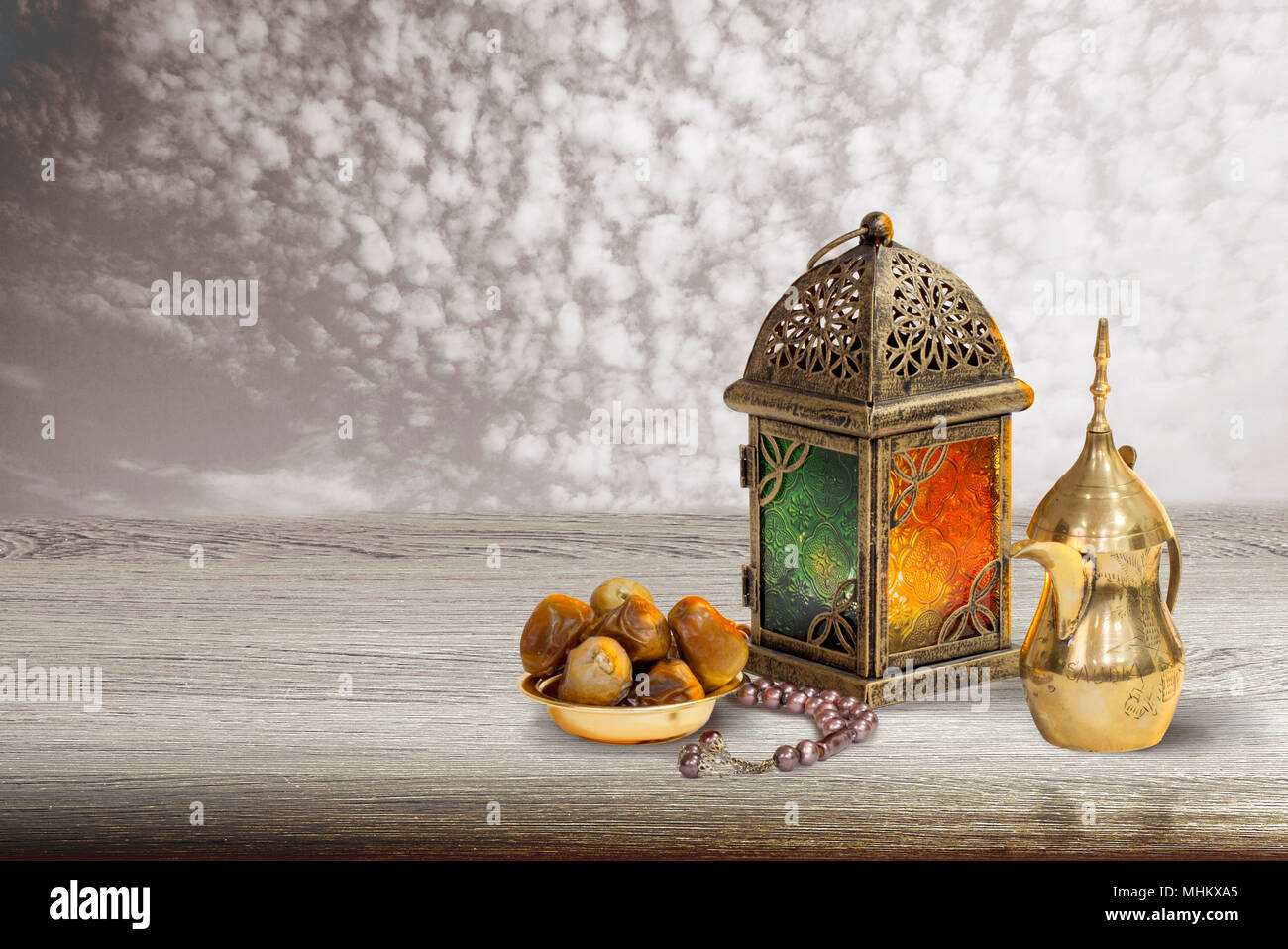 Traditional golden Arabic coffee set with dallah, coffee pot and dates.