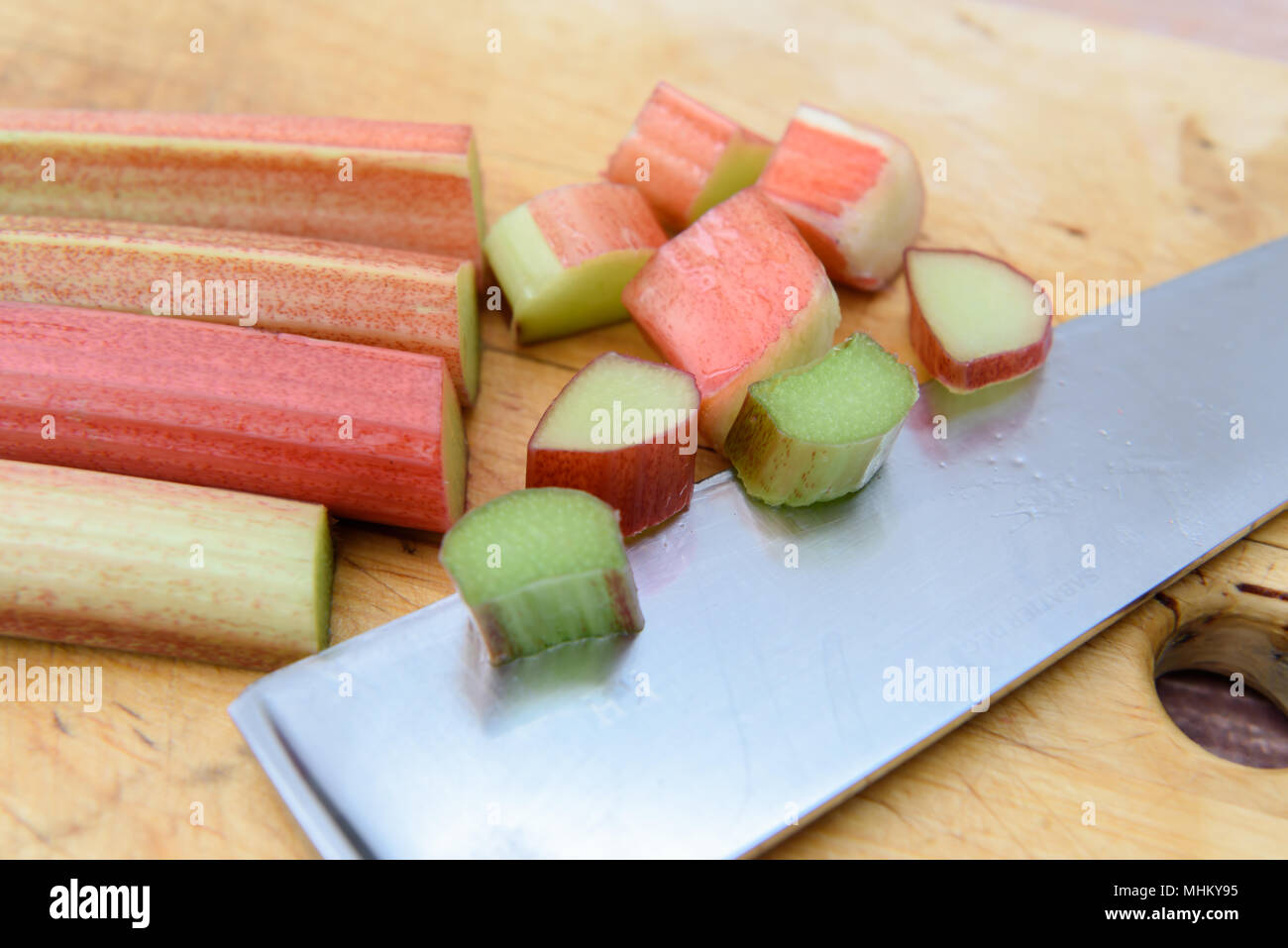 Fresh raw Rhubarb fruit with brown background - Stock Image