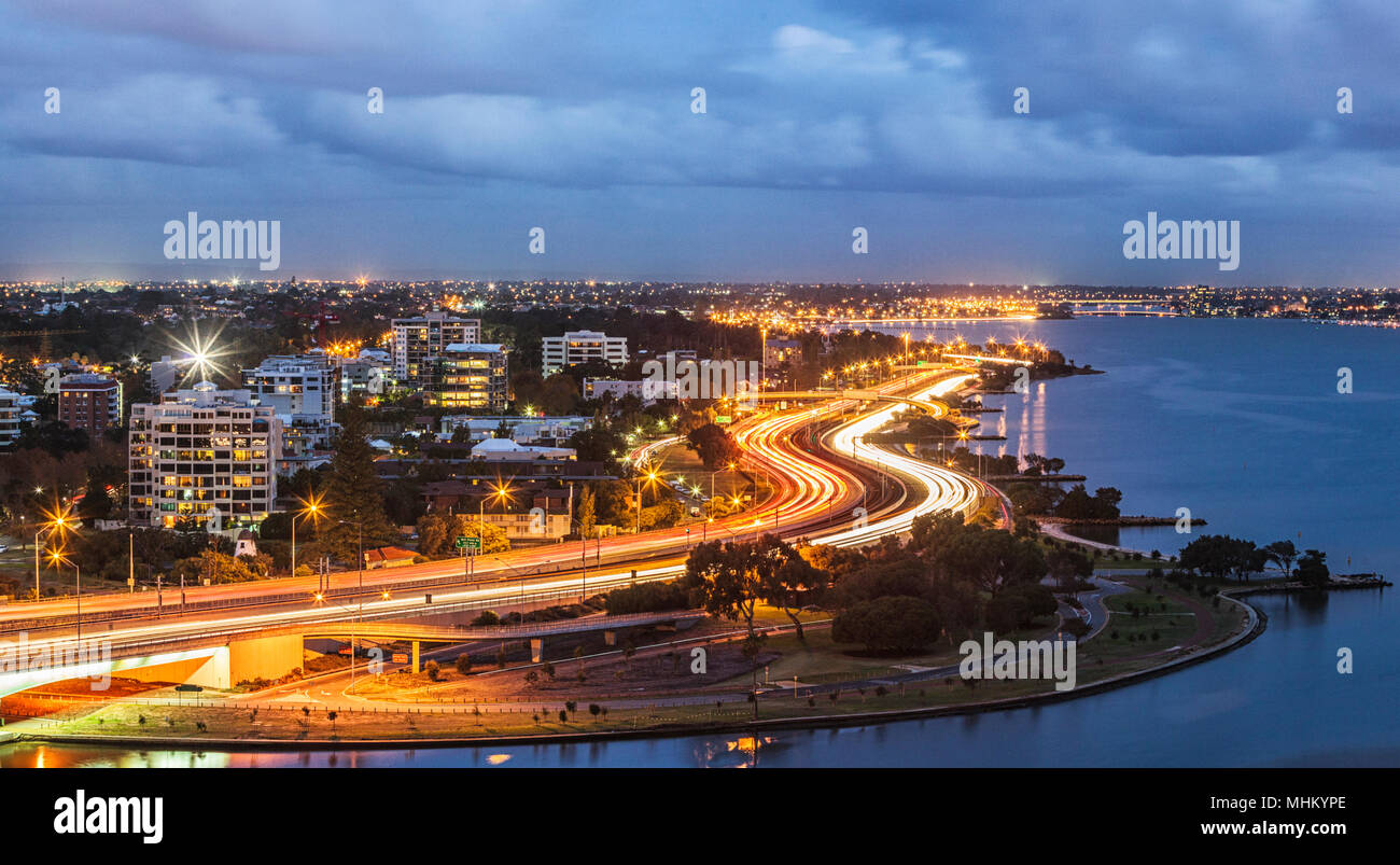 Light trails on a busy Mitchell Freeway at dusk. Perth, Western Australia - Stock Image