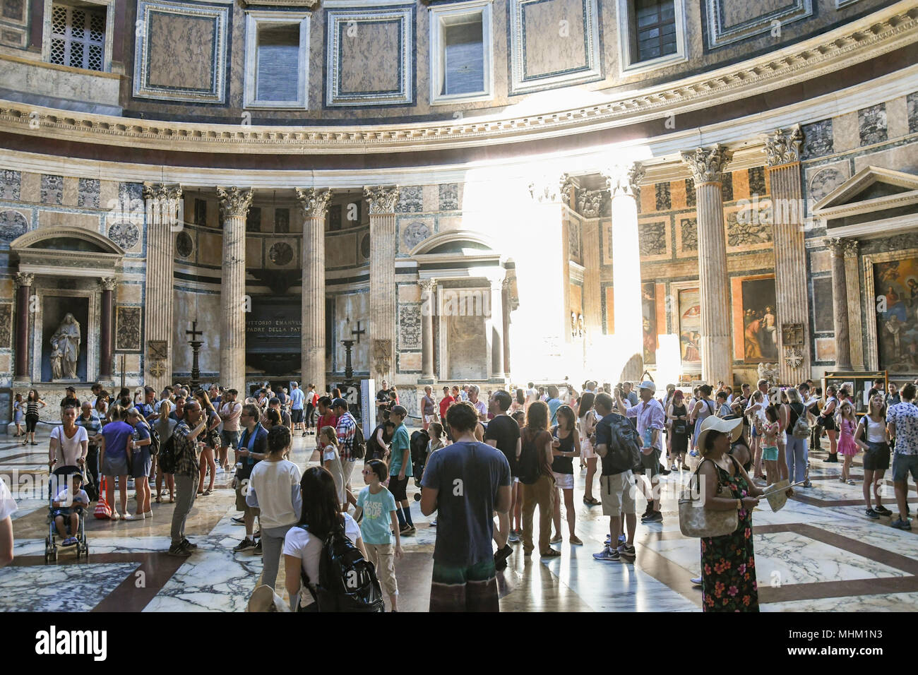 Tourists Inside the pantheon in Rome a former roman temple now a church - Stock Image