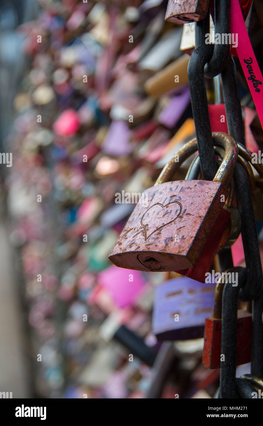 Love Lock with engraved heart on the Hohenzollern Bridge in Cologne - Stock Image