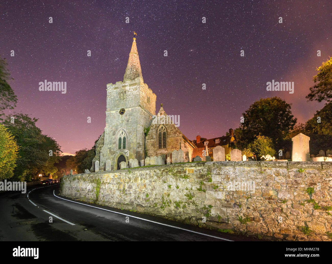Village Church of St Peter at Shorwell under the stars at night - Stock Image