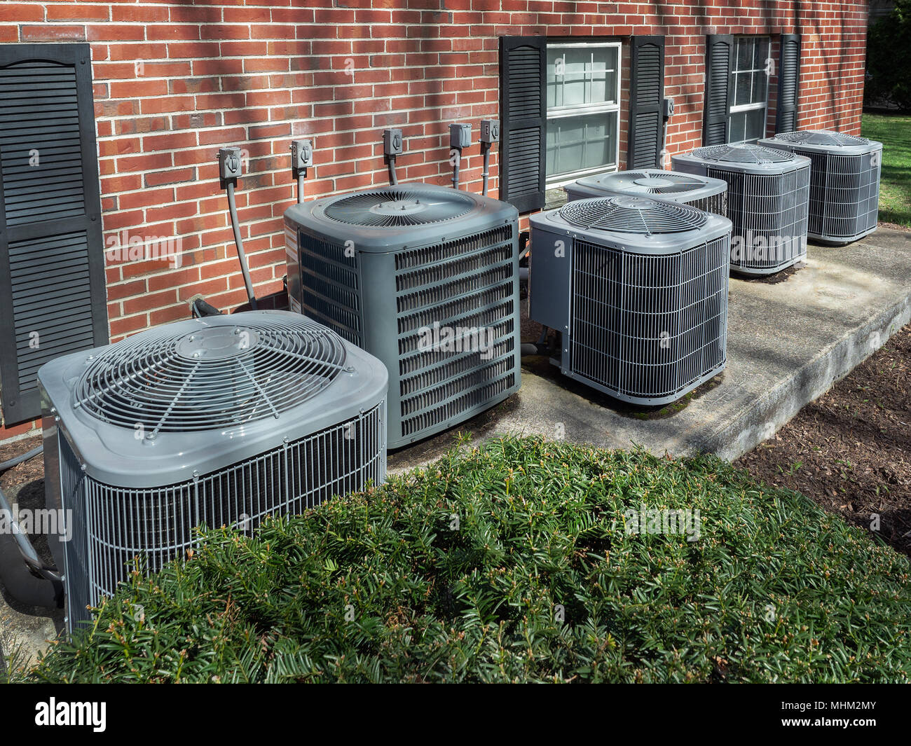 Air conditioning units outside an apartment complex Stock ...